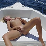 A very sexy and rich bitch posing for your pleasure on a boat