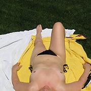 Sunbathing in the backyard minus the bikini topless and full nudity
