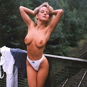 This hot blonde is so sexy and she knows it posing on bridge