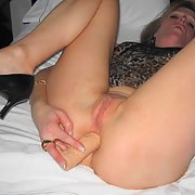 sexy milf and her toy using it on her bum and vagina