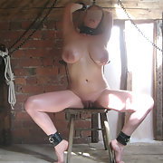 More pictures of my luscious wife chained in bondage