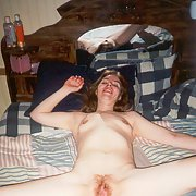 Redhead Mrs Malone nude at home on the bed erotic pics