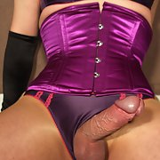 Tranny Slut Wearing A Purple Corset