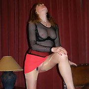 Mature lady dressing to please her man heels short skirt see through