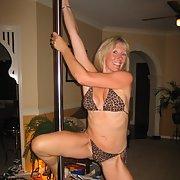 Stunning blonde milf having some adult fun pole dancing at home