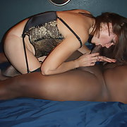 Sexy milf enjoying her black love tool while hubby watches on
