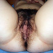 My wifes hairy pussy please enjoy see how hairy she is