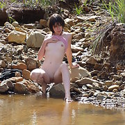 My wife on vacation striping off nude in the river bending over