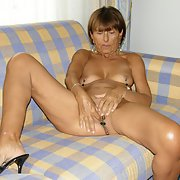 Mature nude woman using clips on breasts and vagina