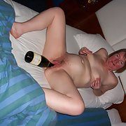 After the champagne is drunk she fucks herself with the bottle