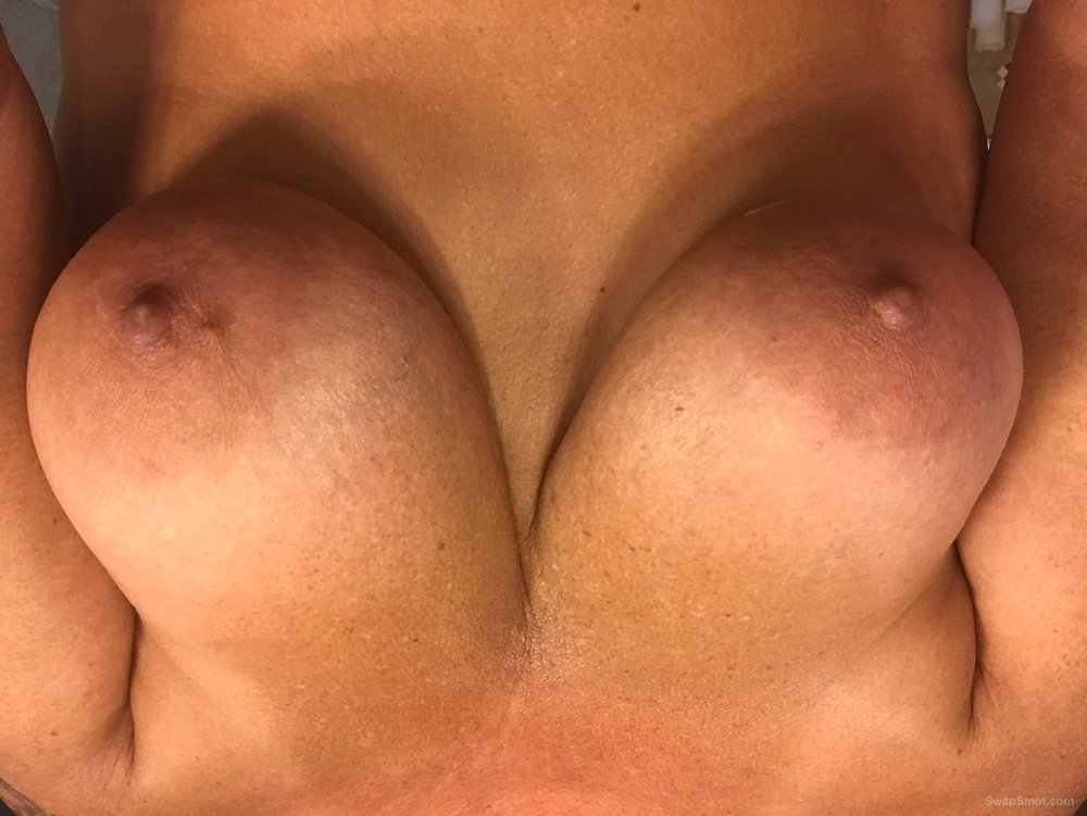 My beautifuls wife's tits while in the shower