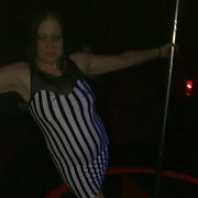 Pole dancing at a swingers club