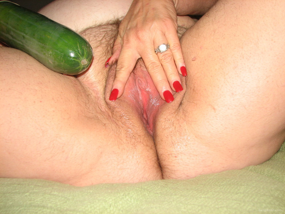 My wife home alone and got horny using a vegetable as a sex toy