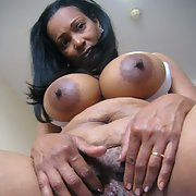 Chubby black mature with huge natural tits and massive areolas