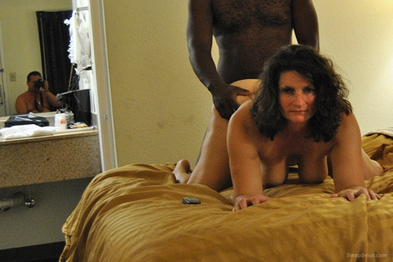 Mature fucking in doggy style by her lover while her husband takes pic