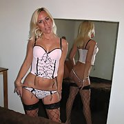 sexy blonde milf posing for erotic pics in lingerie