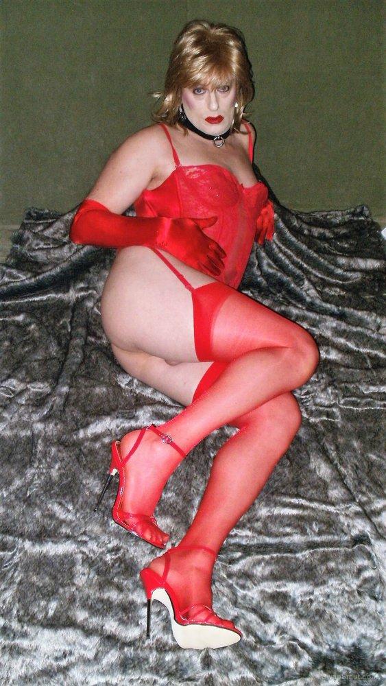 Pierced sissy Rachel exposed in red lingerie and heels