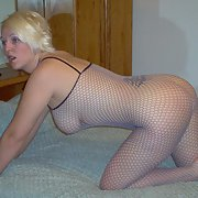My hot wife dressed up wearing a fishnet body stocking showing all