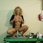 Blonde girlfriend fooling around in the garage with my tools