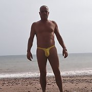 Out doors in thongs and nude with people walking bye