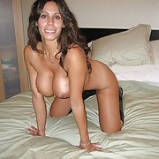Really hot brunette milf with big tits putting on a real show