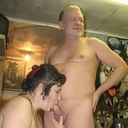 Mature wife having fun with one of her sex toys sucking his cock