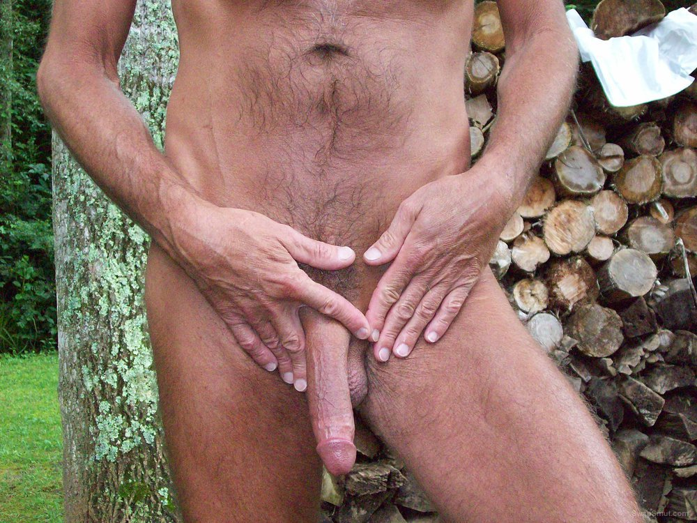 Living in the country is great walking around nude showing my cock