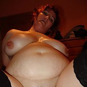 Mature amateur BBW posing naked engaging in sex acts