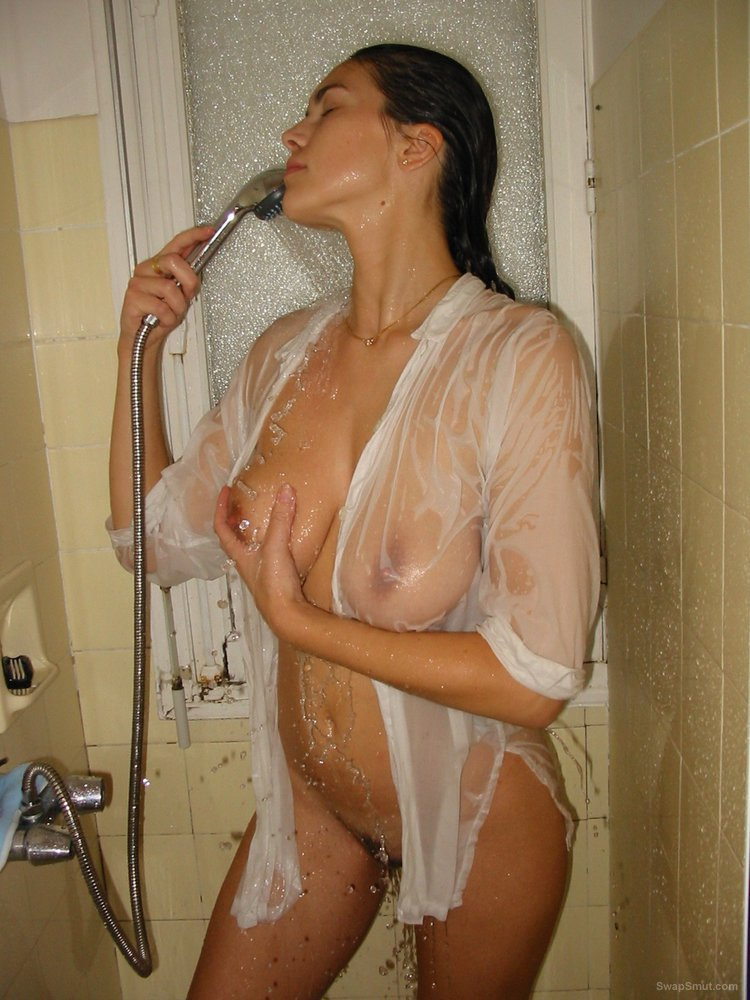 Wife in the shower caressing her lovely breasts pussy and bum