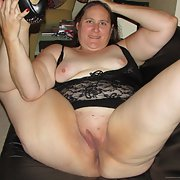 Black on black showing my pussy and BBW body off on leather couch