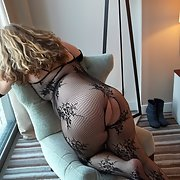Sexy milf Teacher wearing fishnet body stocking