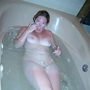 Amateur photos of me revealing my boobs and pussy while in the bath