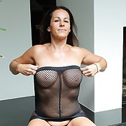 Smoking hot mature brunette milf with super sexy figure and boobs