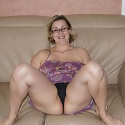 Sexy wife being lazy around the house well hubby snaps away part 2