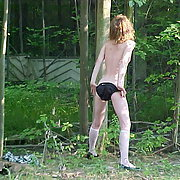 Sexy woman stripping in the woods getting completely naked