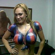Pole dancing slut with body painted football shirt big boobs and nips