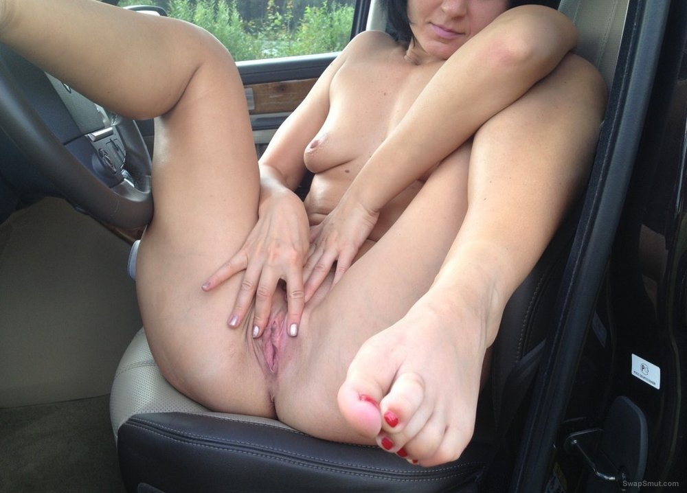 Sexy dark haired amateur playing with herself in the car