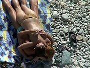 Sexy nude bitch fucking on a pebble beach voyeur sex video