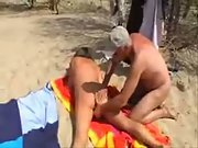 My slut wife with a stranger at a nude beach