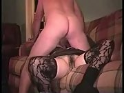 Wife garters and stockings sex on the couch