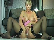 Pretty mature woman with big tits squirts while masturbating