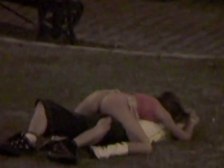 Young couple caught having sex in public park at night making out
