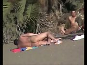 Filming discreet horny couples having sex in public on a nudist beach