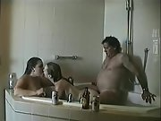 Hot young wives enjoy threesome sex with an older man in the bathtub